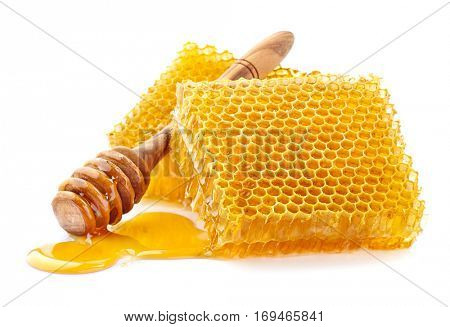 Honeycombs with wooden spoon in closeup