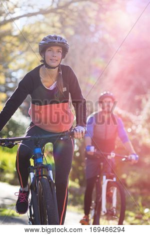 Smiling biker couple cycling in countryside
