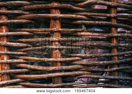 Wickerwork woven background texture of wood, old fence