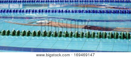 ST. PETERSBURG, RUSSIA - DECEMBER 17, 2016: Athlete competes in 1500 m freestyle swimming competition during X Salnikov Cup. Athletes from 6 countries participated in the competitions