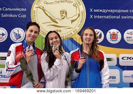 ST. PETERSBURG, RUSSIA - DECEMBER 17, 2016: Winners of X Salnikov Cup in women 200 m breaststroke swimming Maria Temnikova (center), Sofia Andreeva (left) and Maya Mitrofanova, all from Russia