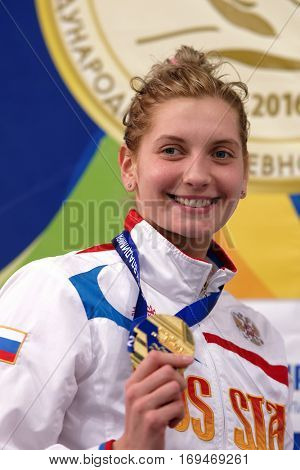 ST. PETERSBURG, RUSSIA - DECEMBER 17, 2016: Bronze medalist in women 200 m butterfly swimming Ekaterina Lvova in medal ceremony of X Vladimir Salnikov Cup. Athletes from 6 countries participated