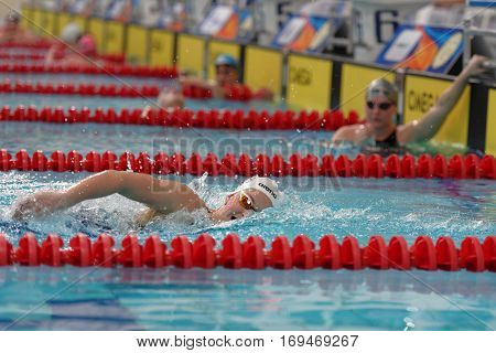 ST. PETERSBURG, RUSSIA - DECEMBER 16, 2016: Female athlete competes in 800 m freestyle swimming competition during X Salnikov Cup. Athletes from 6 countries participated in the competitions