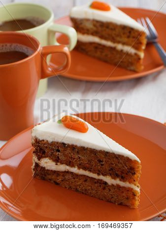 Two slices of carrot cake with hot chocolate