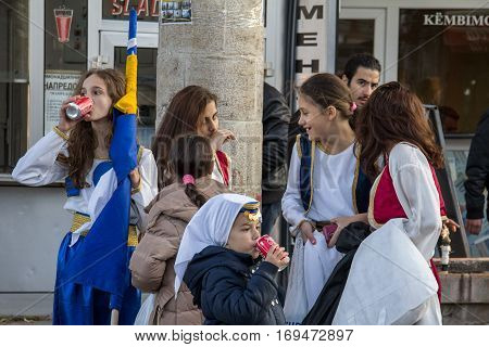 SKOPJE MACEDONIA - OCTOBER 24 2015: Bosnian folk dance group of girls drinking Coca Cola after a festival performance