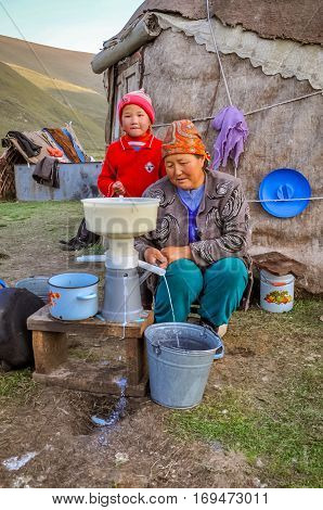 Woman And Her Child In Kyrgyzstan