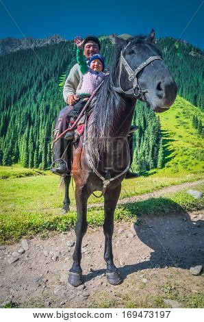 Father With Child In Kyrgyzstan