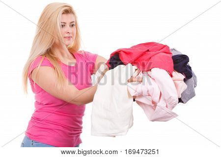 Woman Holding Pile Of Creased Clothes