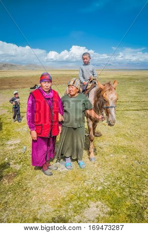 Women With Headcloth In Kyrgyzstan