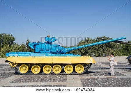 KIEV UKRAINE - AUGUST 9 2015: Russian T55 tank captured in Eastern Ukraine by the Ukrainian army painted with the Ukrainian colors used as a trophy