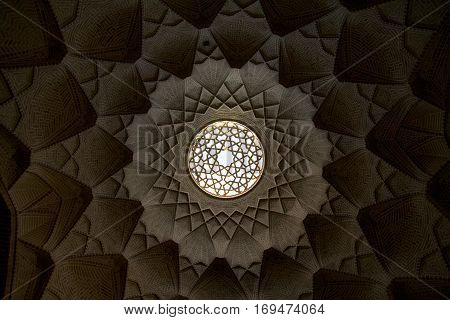 YAZD, IRAN - AUGUST 20, 2016: Light well in Yazd bazar Iran taken from below. In architecture a lightwell light well or air shaft is an unroofed external space provided to allow light and air to enter