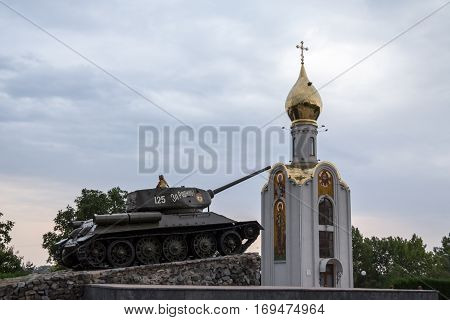TIRASPOL TRANSNITRIA (MOLDOVA) - AUGUST 12 2016: Little Girl playing on the Tank Monument erected to commemorate the 1992 civil war. Transnistria (also called Trans-Dniestr or Transdniestria) is a small breakaway state located between Moldova & Ukraine