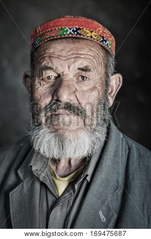 Man With Serious Face In Tajikistan