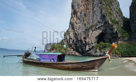 Long tail boat on tropical beach in Krabi, Thailand