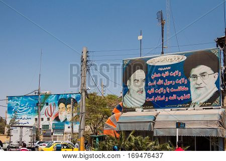 KASHAN IRAN - AUGUST 13 2016: billboards showing propaganda for the two Supreme leaders of the Islamic Republic of Iran Sayyed Ali Hosseini Khamenei and Ruhollah Khomeini in the streets of the city of Kashan