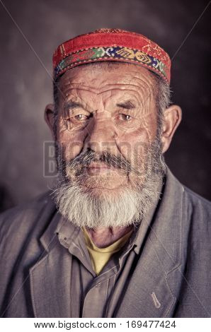 Man With Colourful Cap In Tajikistan