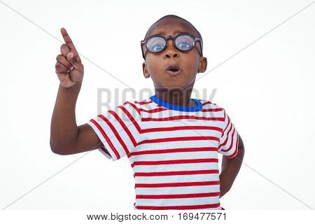 Cute boy shaking finger saying no to the camera on white screen