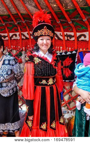 Woman In Red And Black Folk Costume In Kyrgyzstan