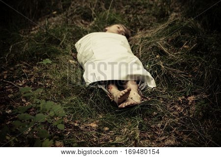 Dead Boy Abandoned In Countryside Under Sheet