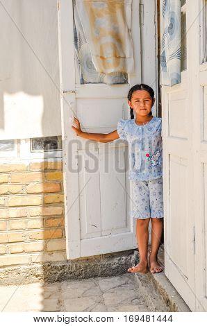 Girl Standing In Doors In Uzbekistan