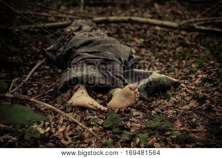 Dead Body Of A Barefoot Boy In The Forest