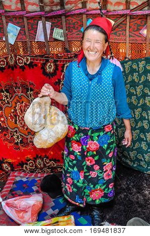 Woman With Flowers On Skirt In Kyrgyzstan