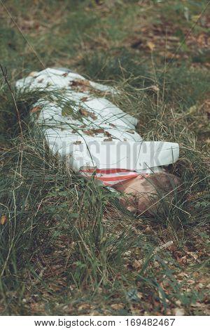 Murder Victim Lying On Grassy Field Under Sheet