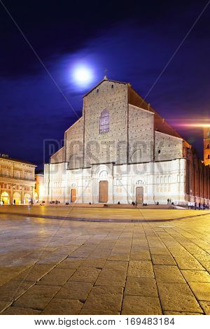 Town square and San Petronio church in Bologna at moonlit night, Italy. Copyspace composition.