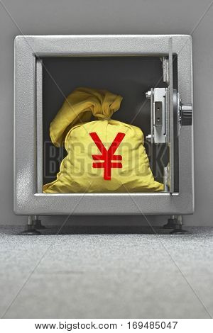 Bag of money with yen sign in open locker