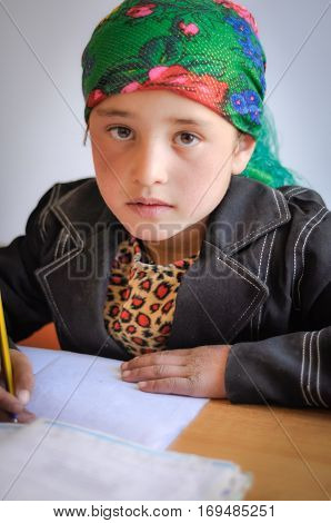 Girl With Colourful Headcloth In Tajikistan