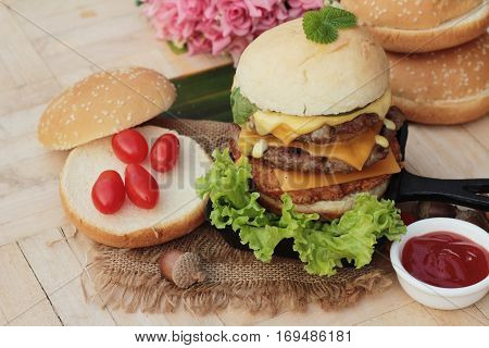 Double hamburger with double cheese is tasty