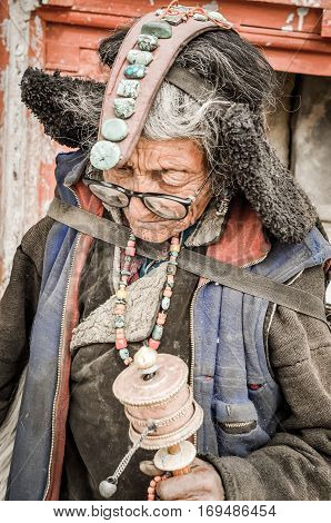 Woman With Stones In Ladakh