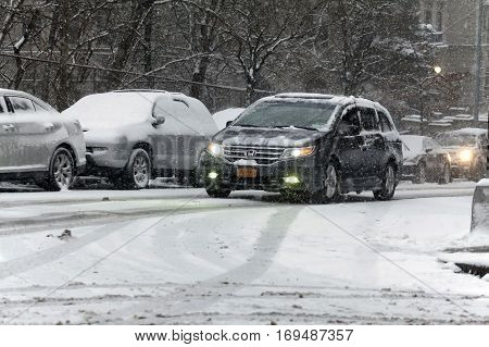 BRONX NEW YORK - JANUARY 7: Car drives in snow storm. Taken January 7 2017 in New York.