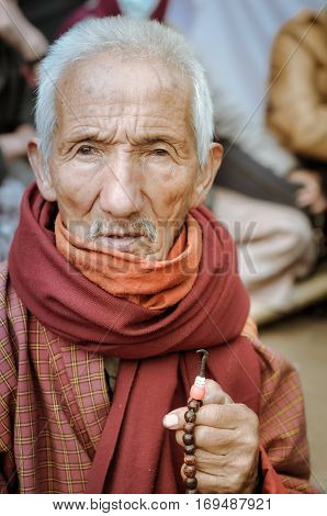 Old Man With Rosary In Bihar