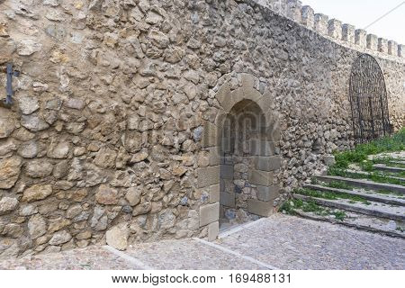 Summer travel, Stone walls of a medieval castle. Town of Consuegra in the province of Toledo, Spain