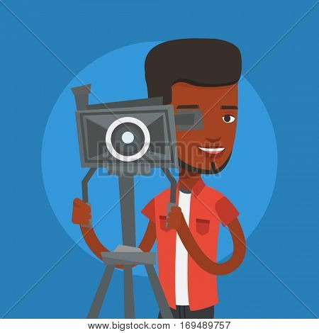 African-american cameraman looking through movie camera on a tripod. Young cameraman with professional video camera. Smiling cameraman taking a video. Vector flat design illustration. Square layout.
