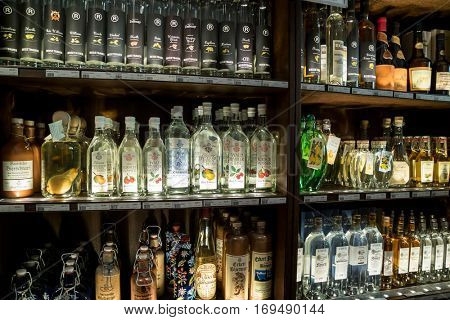 Munich, Germany - August 6, 2016: Showcase with different varieties of alcohol in the Alois Dallmayr. Coffee and Food Store located near Marienplatz in Munich
