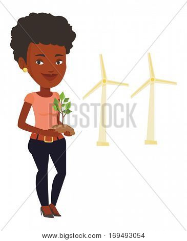 An african worker of wind farm. Woman holding in hands green small plant in soil on the background of wind turbines. Green energy concept. Vector flat design illustration isolated on white background.