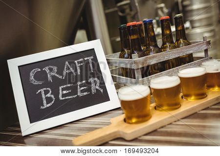Sign board with beer samples on table at brewery
