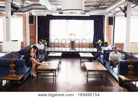 Businesspeople Working In Relaxation Area Of Modern Office