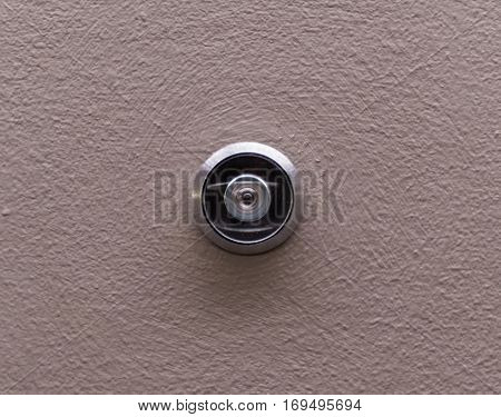 Peep Hole on Tan Painted Door centered