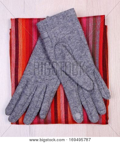Gloves And Scarf On Wooden Background, Clothing For Autumn Or Winter
