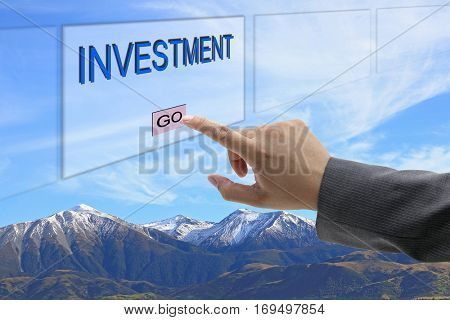 asian business man hand push on Investment button on touch screen panel