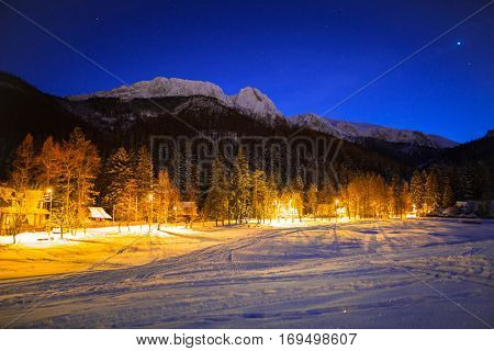Stra?yska valley and Giewont in Tatra mountains at night. Silhouette of sleeping knight.