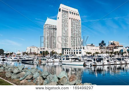 SAN DIEGO, CALIFORNIA - JANUARY 8, 2017:  Hotels and city skyline at Embarcadero Marina Park North near Seaport Village.