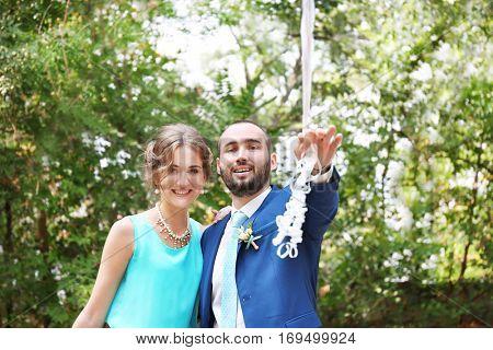 Beautiful bridesmaid and groomsman in park