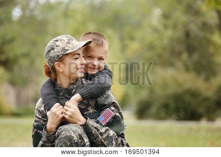 Soldier reunited with her family on a sunny day