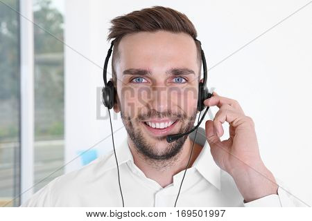 Young handsome technical support dispatcher working, closeup
