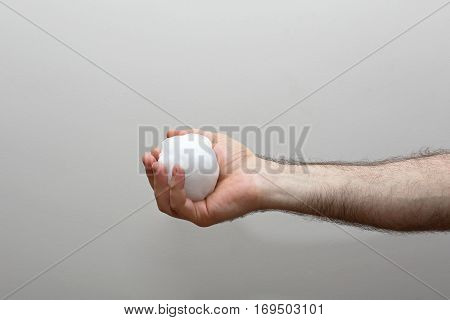 Man Holding Frozen Snowball in Hairy Hand