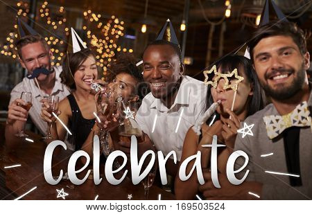 Friends celebrating New Year'?s Eve at a party in a bar